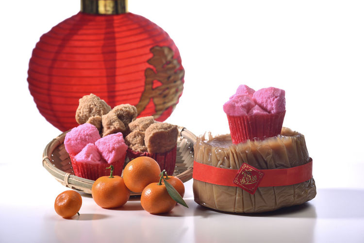 Chinese New Year atmosphere Celebration Congratulations Kung Hei Fat Choi New Year Orange Auspicious Blessing Celebration Chinese New Year Close-up Day Festival Food Food And Drink Freshness Happy New Year Indoors  Joy No People Ready-to-eat Rice Cake Still Life Studio Shot Sweet Food White Background