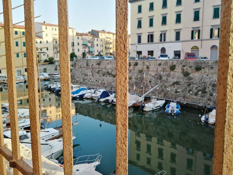 EyeEm Selects EyeEm Best Shots Grate Boats Outdoors Day Street River View River Leghorn Fossi Grates Railing Railings And Iron Building Exterior Built Structure Water Water Reflections Tuscany Street Photography City View  Windows