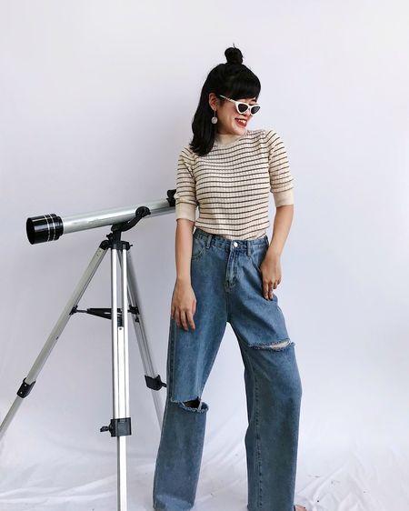 Full length of young woman looking at camera