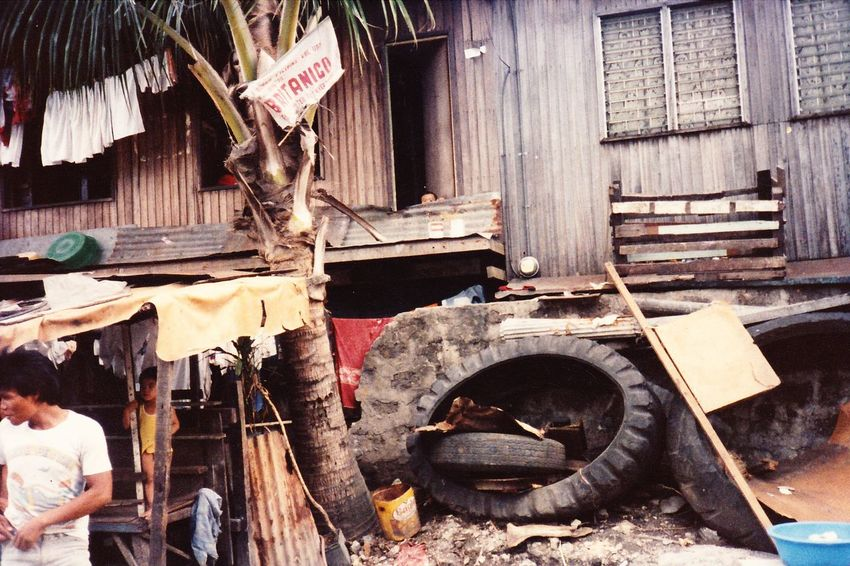 I took this photo in 1987 at the Smokey Mountain slum in Manila. It was my first trip outside of the US and lit the fire in me for public service and travel that has not been quenched. Child Damaged Destruction Heap Memories Philippines Poor  Ruined Slum Smokey Mountain Wood - Material Miles Away