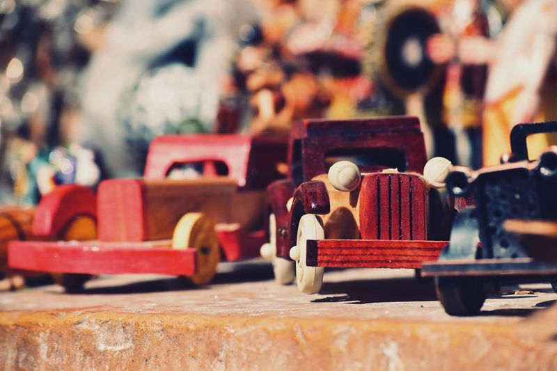 Close up of hand crafted wooden car models/ toys-rajasthan