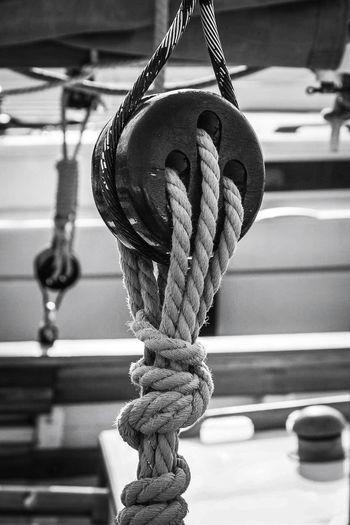 Close-up of rope tied at sailboat