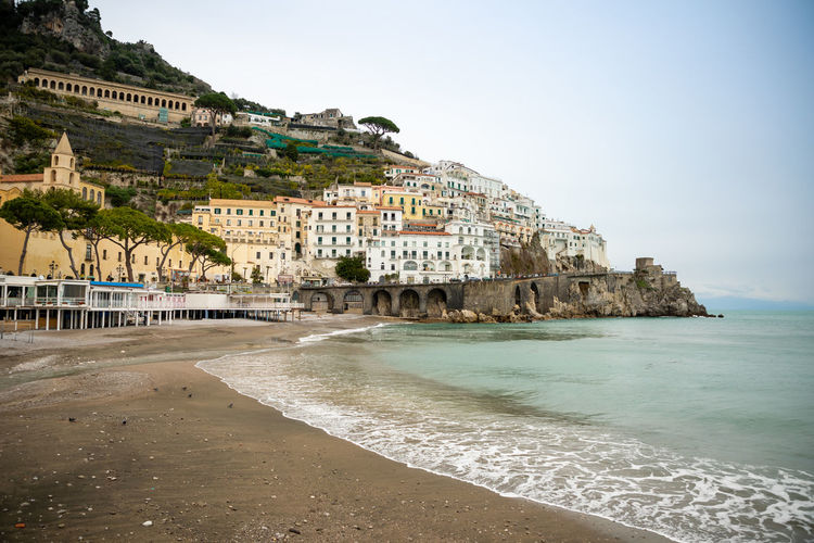 Italy Amalfi  Amalfi Coast Water Built Structure Architecture Building Exterior Sea Beach Sky Land Building Nature Day Travel Destinations Tourism Clear Sky Beauty In Nature Travel Scenics - Nature City No People Outdoors