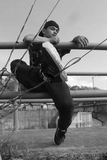 Full length of happy boy holding slide in playground