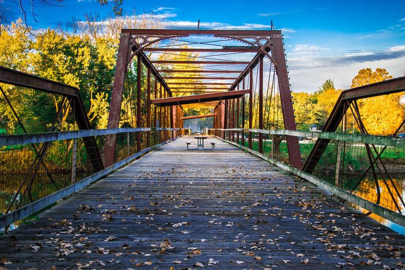 Bridge Over River During Autumn