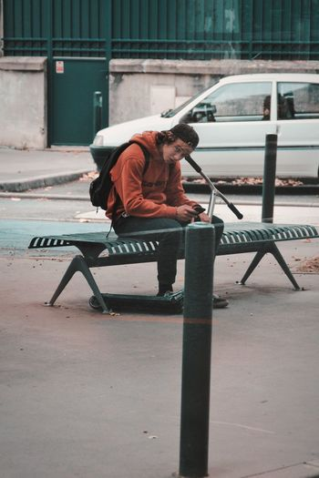 Man working on bench in city