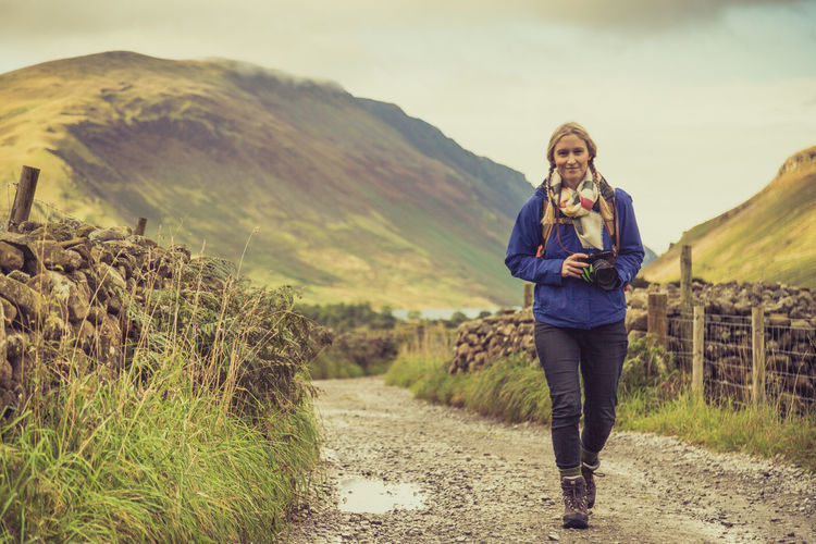 Exploring the valleys around the Wasdale valley in the English Lake District, with my friend keeping me company :) TravelAdventure Beauty In Nature Casual Clothing Day Dirt Road Focus On Foreground Footpath People And Places Green Color Leisure Activity Lifestyles Mountain Mountain Range Nature Non-urban Scene Outdoors Person Scenics Standing The Way Forward tranquil scene Tranquility Vacations Young Adult