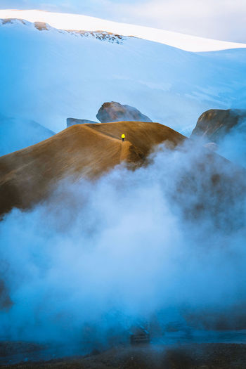 out of the smoke and into the light Check out my prints at https://simonmigaj.com/shop/ and visit my Instagram https://www.instagram.com/simonmigaj/ for more inspirational photography from around the world. Iceland Steam Beauty In Nature Cold Temperature Day Environment Hot Spring Kerlingarfjöll Landscape Mountain Nature One Person Power In Nature Scenics - Nature Smoke - Physical Structure Snow Steam Tranquility Volcanic Landscape Volcano Winter My Best Travel Photo