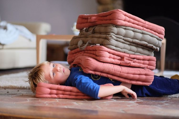 Stack Of Mattresses On Boy