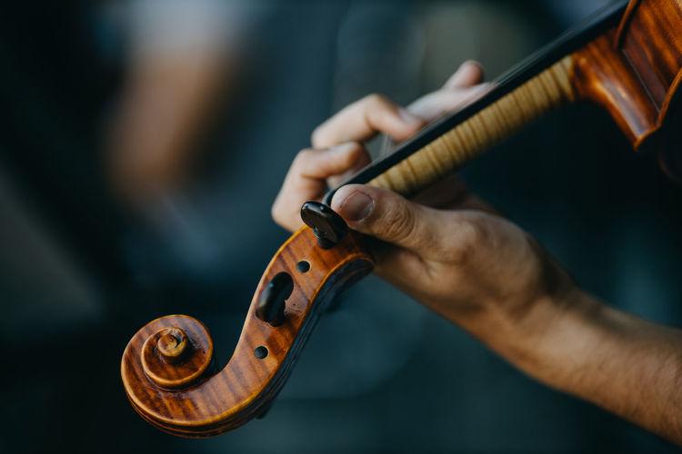 Close up hand holding violin