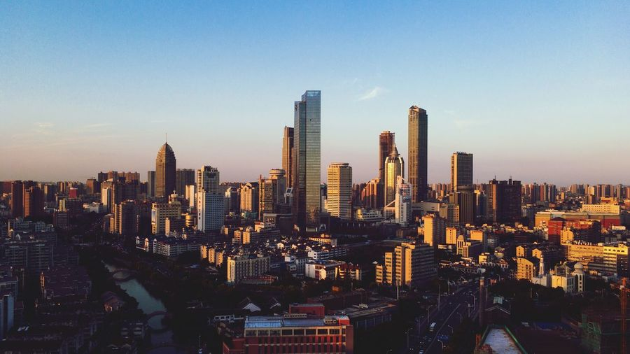 Modern cityscape at sunset in Wuxi Business Finance And Industry Wuxi City Building Exterior Cityscape Office Building Exterior Sky Architecture Building Skyscraper Built Structure Tall - High Modern Urban Skyline Travel Destinations Crowd Residential District Office Clear Sky Landscape Tower Nature