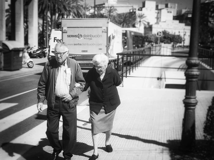 City Street Two People Adult Walking Real People Togetherness Iphonephotography Day ÍPhotoJournal IPhone7Plus Close-up Depth Of Field IPhoneography IPhone Snapseed Iphoneonly Outdoors Photography Mature Adult Love Streetphotography The Street Photographer The Street Photographer - 2017 EyeEm Awards