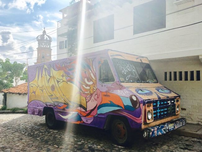 Van art Travel Destinations Traveling Car Travel Tourist Attraction  Mexico Street Photography Street No People Building Exterior Derelict & Abandoned Graffiti Art Cathedral Sunray Sunrays_penetrating_clouds Grafitti Outdoors