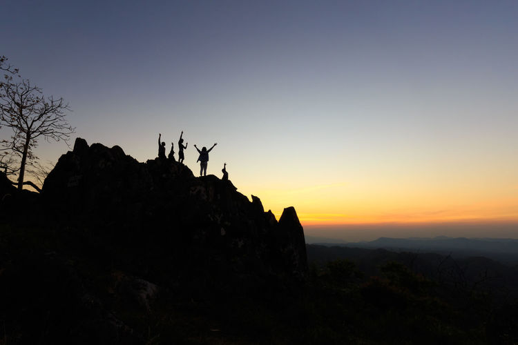 People Standing On Silhouette Landscape
