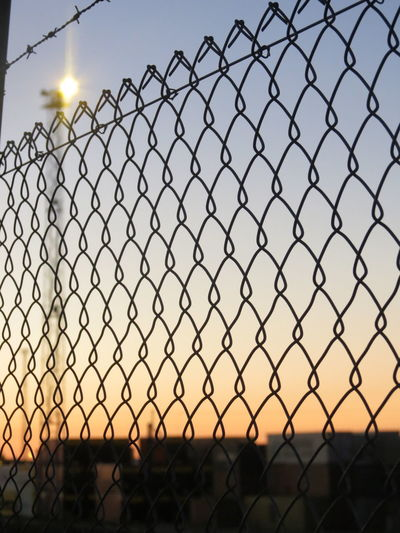 Security Fence Protection Chainlink Fence Safety Barbed Wire Trapped Sky No People Wire Mesh Outdoors Day Rail Transportation Transportation Tracks Train Railroad Palmerston North Nz Railway Dusk Orange Glow Sunset Colours Rail City Built Structure