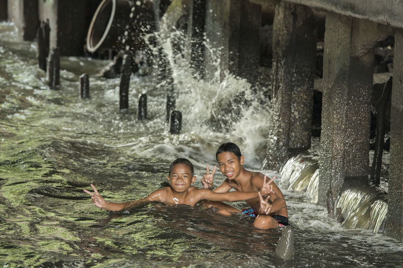 Portrait of children playing in sea