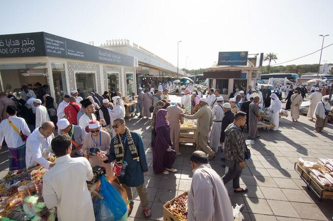 Muslim Devotees Buying Souvenirs For Their Love Ones At Quba Mosque On A Sunny Day. Crowd Eid Eid Mubarak Gift Hajj Islam Mecca Medina Money Muslim Ramadan  Ramadhan Saudi Arabia Shopping Souvenir Syawal Umrah