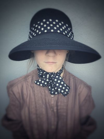 Young girl with a hat. Hat Waist Up Polka Dot Childhood One Person Real People Moody Faded Hidden Dress Up Girl Lonely Loneliness Alone Selective Focus The Week On EyeEm Fashion Mix Yourself A Good Time