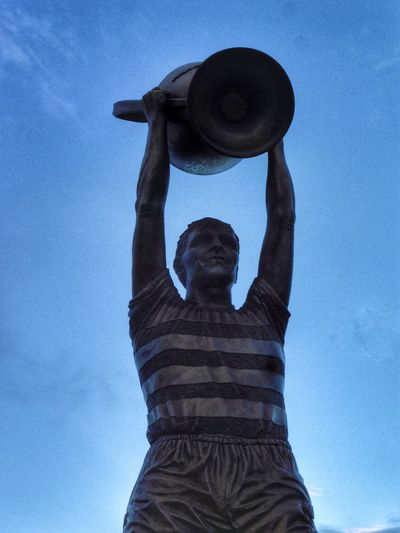 Billy McNeill statue Scottish Football Glasgow Celtic Lisbon Lions Scotland Billy McNeill Statue Low Angle View One Person Hat Clothing Blue Sky Adult Day Lifestyles Nature Arms Raised Architecture