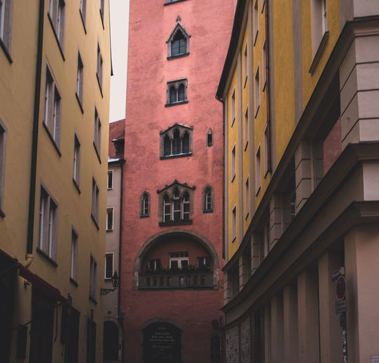 // moody Regensburg // Architecture City Architecture Building Building Exterior Built Structure City Cityshapes Cropped Day Moody No People Old Outdoors Purple Residential Building Sky Unicef Vintage Window Yellow