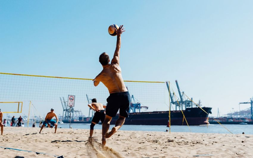 Harbour beach... Hamburg Beach Sand Playing Sport Shirtless Full Length Day Leisure Activity Competition Lifestyles Clear Sky Sportsman Men Outdoors Competitive Sport Sky Real People Beach Volleyball Sports Team Sommergefühle EyeEm Selects Sommergefühle EyeEm Selects Second Acts