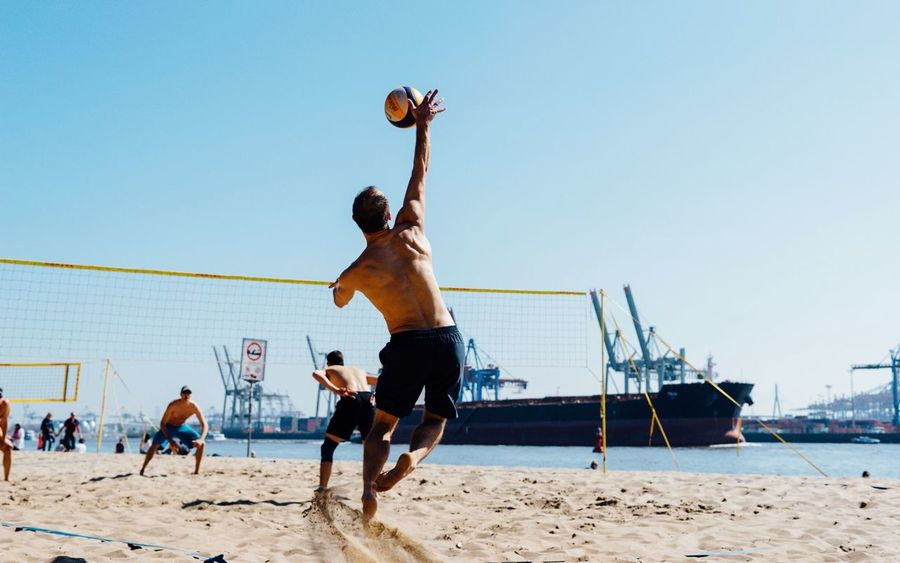 Harbour beach... Hamburg Beach Sand Playing Sport Shirtless Full Length Day Leisure Activity Competition Lifestyles Clear Sky Sportsman Men Outdoors Competitive Sport Sky Real People Beach Volleyball Sports Team Summer In The City