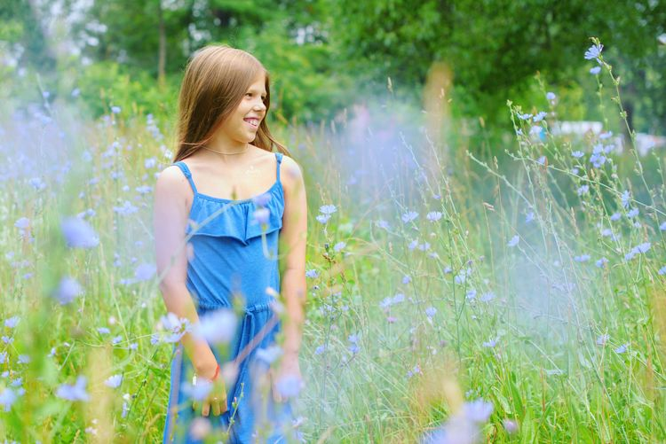 Teenage girl smiling on field