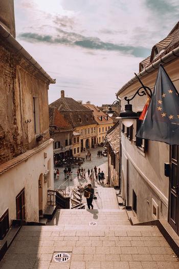 People walking on street amidst buildings in town