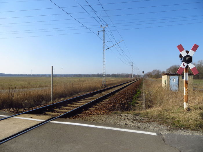 Here Belongs To Me Blue Clear Sky Day Diminishing Perspective Electricity Pylon Field Grass Here Belongs To Me Landscape Mode Of Transport Power Line  Rail Transportation Railroad Track Road Sky The Way Forward Transportation Travel Vanishing Point