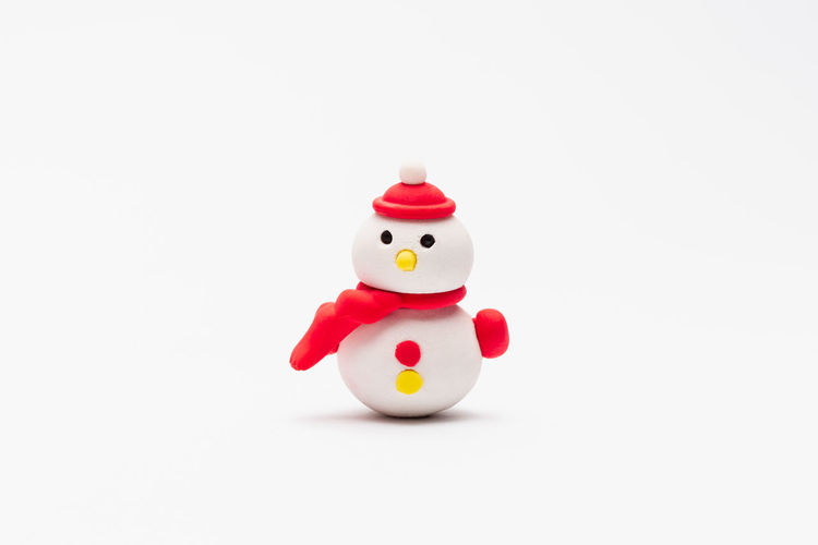 Close-up of toy figurine against white background