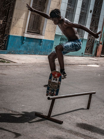 Boy skateboarding in the streets of Havana Cuba Cuba Collection Havana, Cuba Balance Casual Clothing City Cuban Life One Person Skateboard Sports Sports Equipment Street Photography Streetphotography Vitality Summer Sports EyeEmNewHere