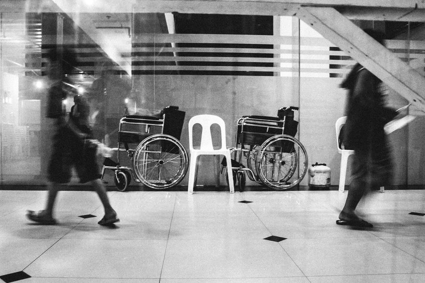 Streetphotography Streetscene Blurred Motion Real People Motion Full Length Lifestyles Bicycle Men Walking Indoors  One Person Women Architecture Transportation Built Structure Standing Illuminated Low Section Day City People Blackandwhite Streetphoto_bw Bnw_collection