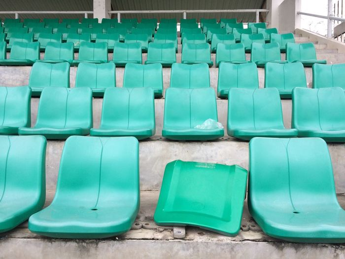 Empty chairs in row at stadium