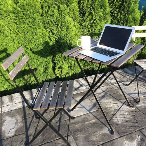 Freelance Life Home Office MacBook Bushes Chair Computer Connection Convenience Day Digital Nomad Green Color Internet Keyboard Laptop Nature No People Outdoor Office Outdoors Portability Table Technology Tree Using Laptop Wireless Technology Work From Home