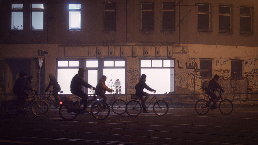 People riding bicycle on street