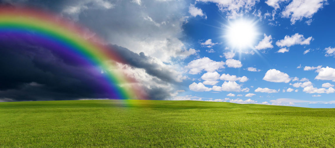 Rainbow and sun Sky Environment Rainbow Grass Nature Landscape Sunlight Spectrum Field Sun Meteorology Purity Beauty In Nature Weather Spring Clouds Change Happy Ecology Hope Beauty In Nature Season  Abstract Panorama Thunderstorm