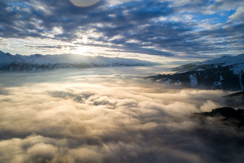 Alps Austria Zell Am See Winter Mountain Mountain Range Landscape View Sunset No People Tranquility Cloud - Sky Beauty In Nature Sky Nature Valley Cloud Cover Sunlight Romantic Sky Romantic Wild Aerial View Aerial Cloudscape Majestic The Great Outdoors - 2019 EyeEm Awards
