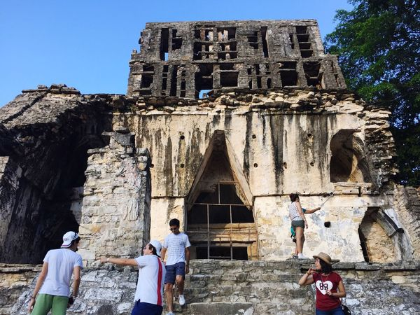 History Building Exterior Architecture Built Structure Real People Old Ruin Lifestyles Ancient The Past Religion Place Of Worship Clear Sky Low Angle View Outdoors Spirituality Men Leisure Activity Day Ancient Civilization Women Tourism Ancient