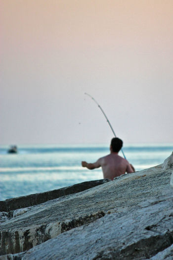 http://www.head-eye-heart.com Beauty In Nature Day Fisherman Fishing Focus On Foreground Horizon Over Water Leisure Activity Lifestyles Nature Ocean Outdoors Puglia Remote Scenics Sea Sea And Sky Shore Sky Tranquil Scene Tranquility Water