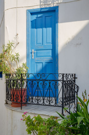 Architectural detail in Paros, Greece Paros Architecture Blue Building Exterior Built Structure Cyclades Day Door Doorway Entrance Flower Greece Lefkes No People Outdoors Plant Potted Plant Traditional Whiewashed White Color