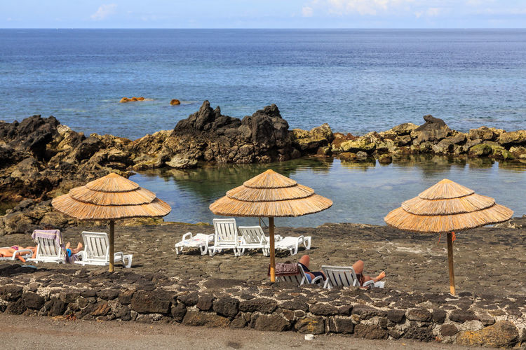 Azores Pico Island Animal Animal Themes Beach Beauty In Nature Day Horizon Horizon Over Water Land Nature No People Outdoors Parasol Rock Rock - Object Scenics - Nature Sea Sky Solid Tranquil Scene Umbrella Water