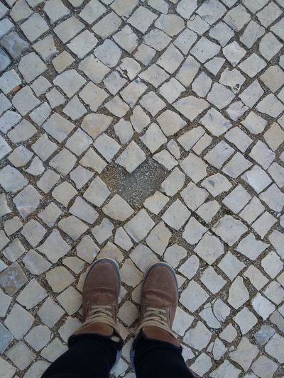 I like small details around us I like to watch and look.Learn & Shoot: Balancing Elements Heart Shape Heart ❤ Cobblestone Pathway Floortraits Looking Down No Edit/no Filter EyeEm Gallery Stone Things I Like Sidewalk Walking Around Detail High Angle View EyeEm Best Shots Eyeem4photography Brown Boots Directly Above Showcase March Details Textures And Shapes EyeEmBestPics Love Is Everywhere Minimalism Floortrait