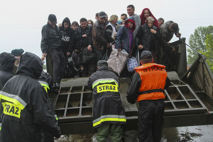 """Reportage """"Ark"""". Pictures taken during the evacuation of Trześn village in the Gorzyce municipality. A high flood wave on the Vistula river surprised the inhabitants at night. Army and amphibian were sent to the rescue. Soldiers reached Gorzyce just before dawn. Early morning military amphibious expedition to the village. I was on the first. Amphibious Vehicle Amphibious Desperation Disaster Flood Large Group Of People Natural Disaster People Real People Rescue Rescue Operation"""