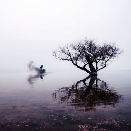 One Person Reflection One Man Only Water Lake Only Men Silhouette Fog Outdoors Beauty In Nature My Best Photo The Traveler - 2019 EyeEm Awards The Minimalist - 2019 EyeEm Awards The Photojournalist - 2019 EyeEm Awards