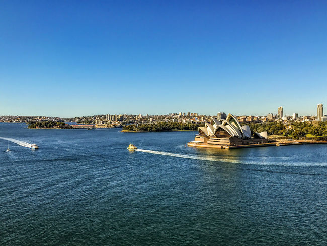 View of Sydney Opera House from Sydney Harbour Bridge. Architecture Blue Building Building Exterior Built Structure City Cityscape Clear Sky Copy Space Cruise Ship Day Nature Nautical Vessel No People Opera House Outdoors Sea Sky Transportation Travel Travel Destinations Water Waterfront