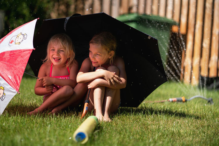 Child Childhood Emotion Females Girls Grass Happiness Leisure Activity Sibling Togetherness Two People Women