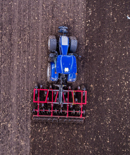 Directly Above Shot Of Agricultural Vehicle On Land