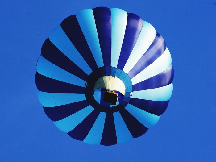 Blue Flying Low Angle View Air Vehicle No People Sky Day Hot Air Balloons In The Sky Close-up Underneath Hot Air Balloon