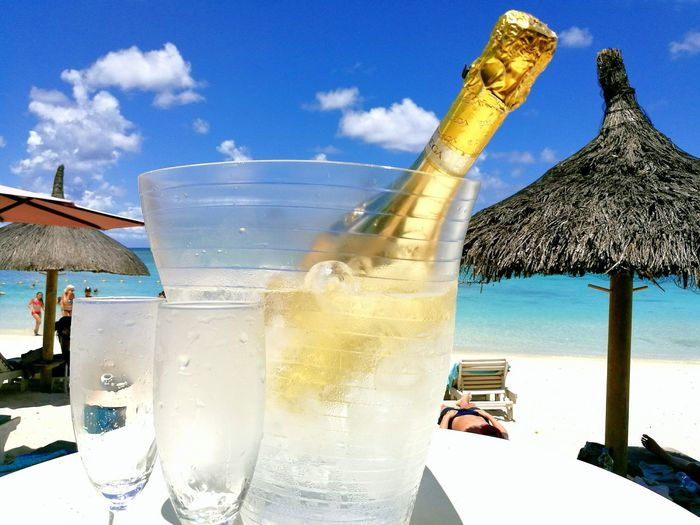 Beauty In Nature Heat - Temperature Beach Mauritius Sunnyday☀️ Champagne Outdoor Photography Champagne-glasses Water Scenics Sky Cloud - Sky New Year Enjoying Life