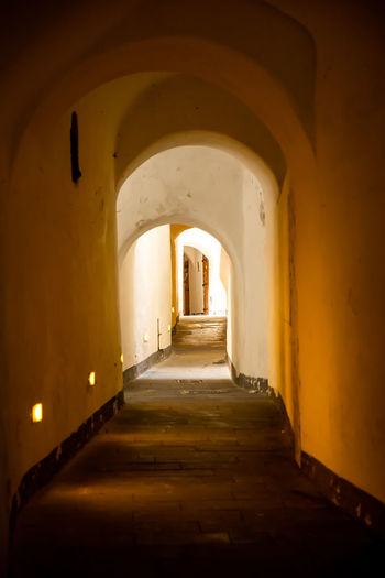 Italy Amalfi  Amalfi Coast Architecture Arch The Way Forward Built Structure Direction Building The Past No People History Arcade Indoors  Corridor Old Empty Illuminated Diminishing Perspective Absence Wall - Building Feature Ceiling Long Arched Light At The End Of The Tunnel